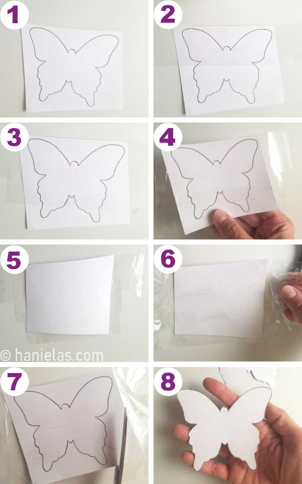 Piece of cardstock with a butterfly outline on a table.