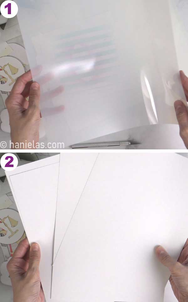 Hands holding cardstock and mylar plastic sheets.