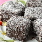 Lamingtons squares on a cake plate.