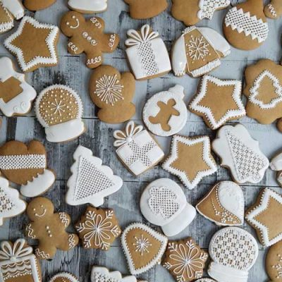 Honey cookies decorated with white icing, displayed on a kitchen counter.