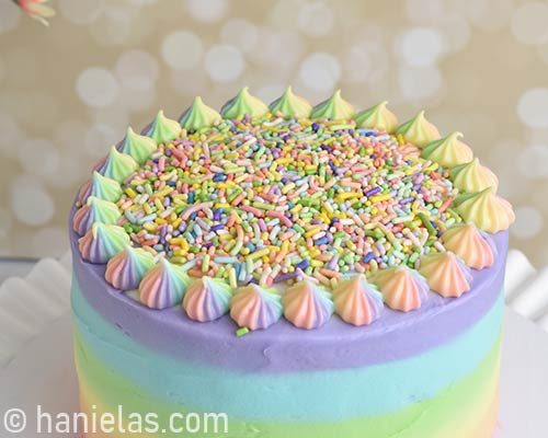 Top of the cake decorated with rainbow sprinkles.