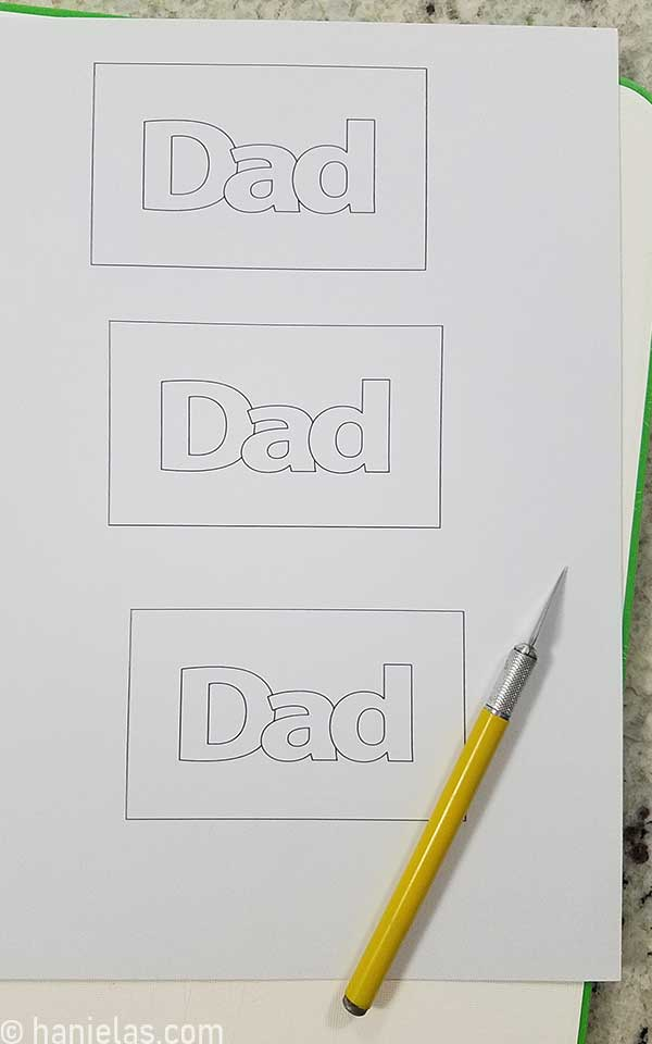 Cardstock with a dad word printed on it.