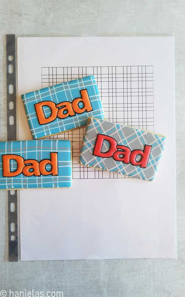 Paper with a printed plaid pattern.