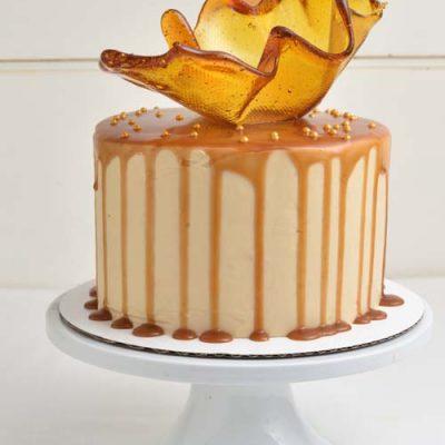 Brown Sugar Cake on a cake stand.