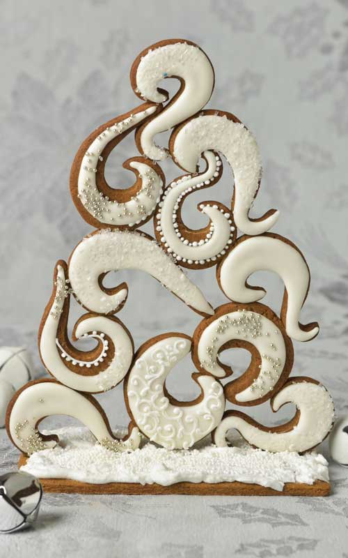 Swirly gingerbread tree centerpiece displayed on a table.