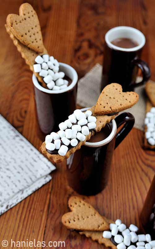 Cookie sticks dipped into hot cocoa.