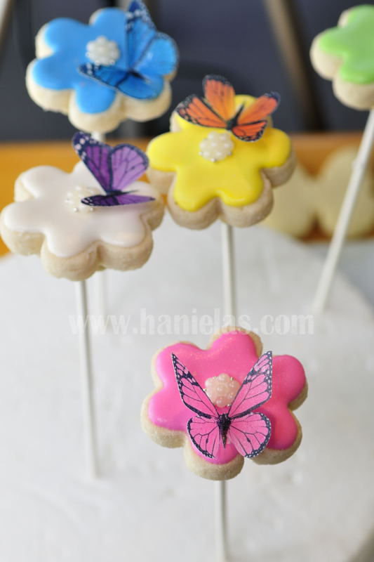 flower cookie pops decorated with wafer butterflies