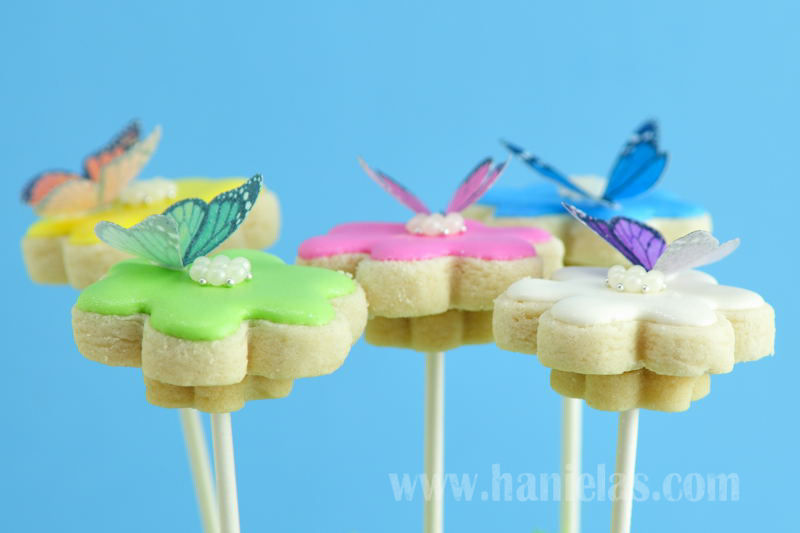 flower cookie bouquet decorated with royal icing and wafer butterlies