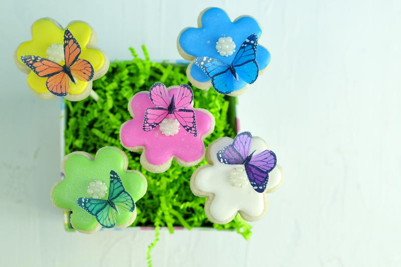 decorate flower cookies arranged in a basket with cringe paper