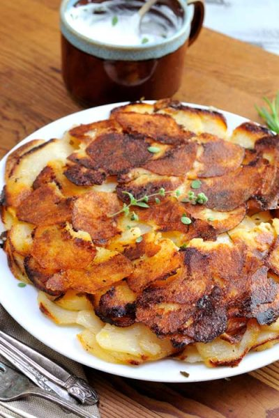Crispy golden brown potato galette on a plate.