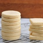 Baked cut out cookies on a cooling rack.