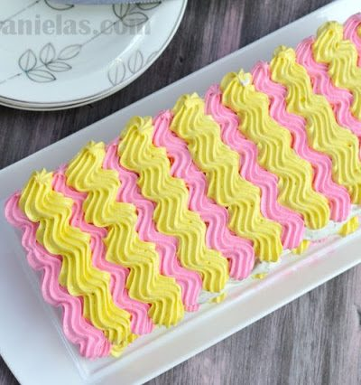 Meringue Chevron Cake with Creamy Filling and Fresh Raspberries
