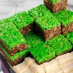 Rice krispie cubes stacked on top of the cake.