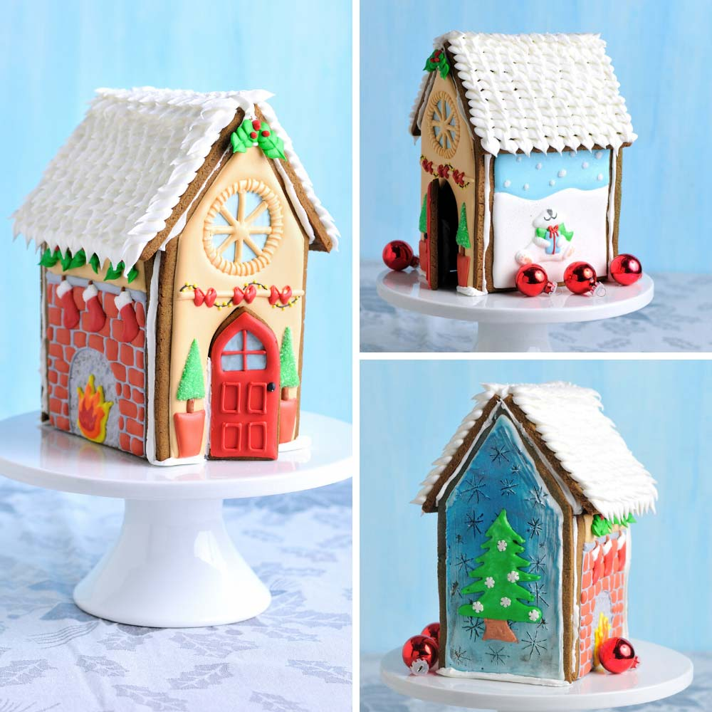 Royal icing decorated gingerbread house displayed on a round cake stand.