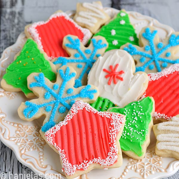 Cookie decorated with buttercream frosting displayed on a pretty festive plate.