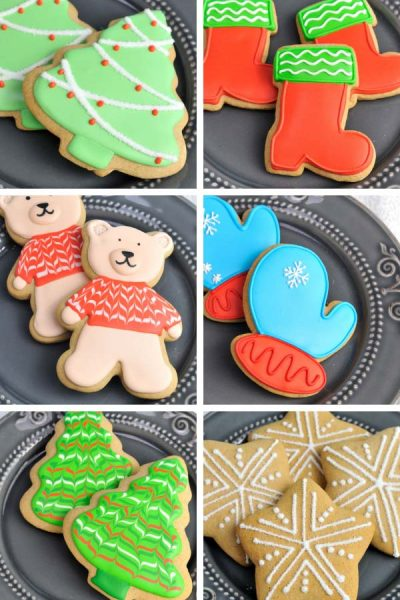 Decorated Christmas Cookies on a gray plate.