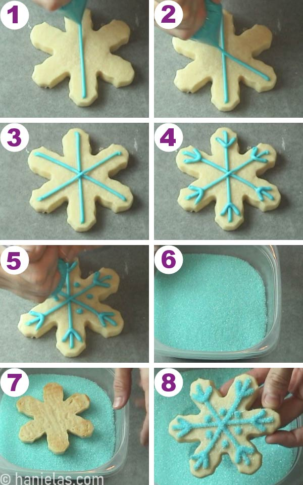 Snowflake cookie with piped blue buttercream designs and dipped in sanding sugar.