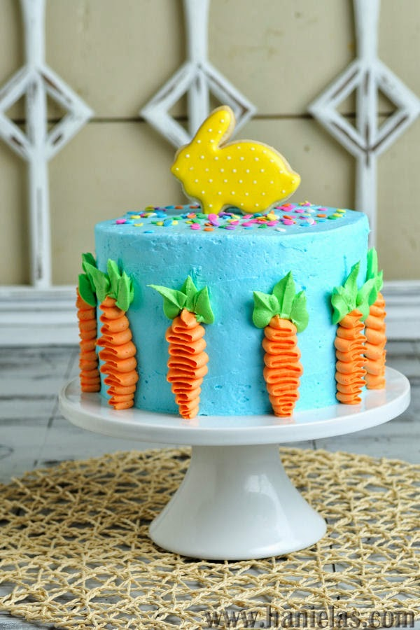 Easter Cake Decorated with Buttercream Carrots and Pretty Bunny Cookie Topper