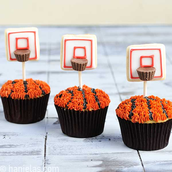 Basketball cupcakes decorated with cookies on a stick.