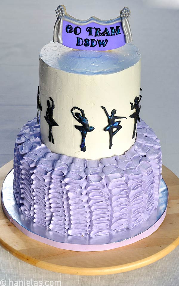 Ballerina cake decorated with a topper cookie pop.