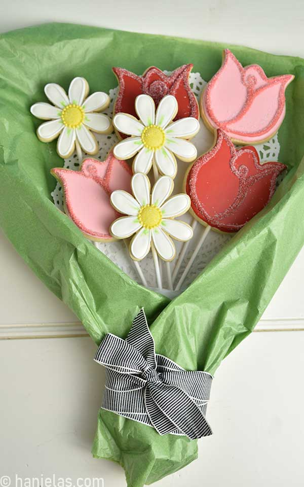 Decorated flower sugar cookies arranged into a flower bouquet.