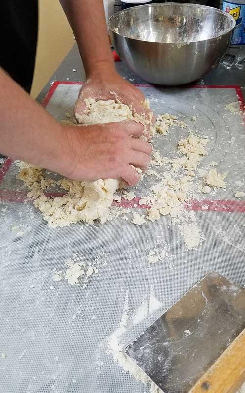 Kneading potato dough.