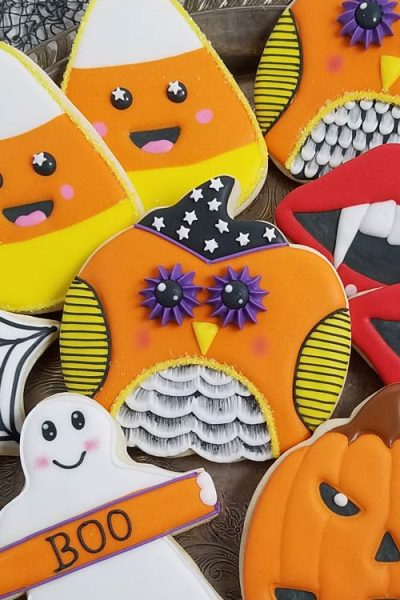 Decorated owl cookies on a tray.