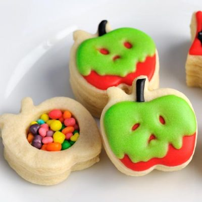Decorated poison apple cookie on a plate.