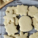 Baked undecorated sugar cookies on a cooling rack