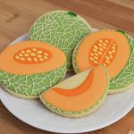 Sugar Cookies decorated like Cantaloupe Cookies on a plate.