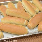 Baked buns on a baking sheet.
