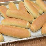 Baked buns on a baking sheet.