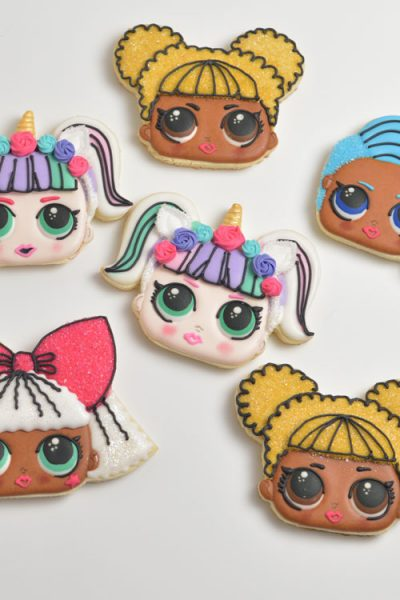 Surprise Doll cookies decorated with royal icing.