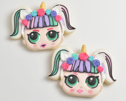 Unicorn doll cookies decorated with royal icing.