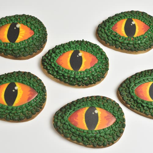 Egg shaped cookie decorated with royal icing to look like an eye.