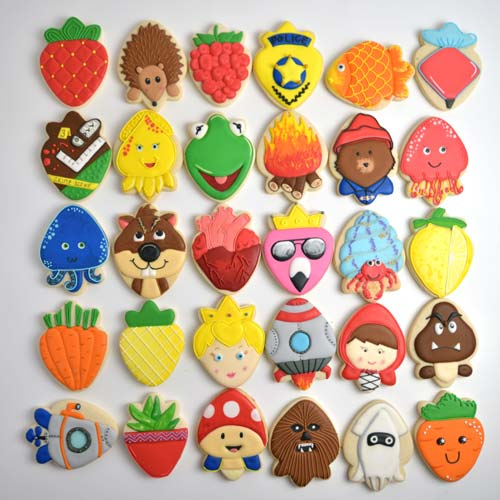 Variety of colorful 30 decorated cookies displayed on white background.