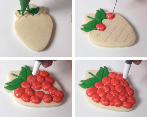 Piping leaves with green royal icing. Piping large dots clustered together with red icing.