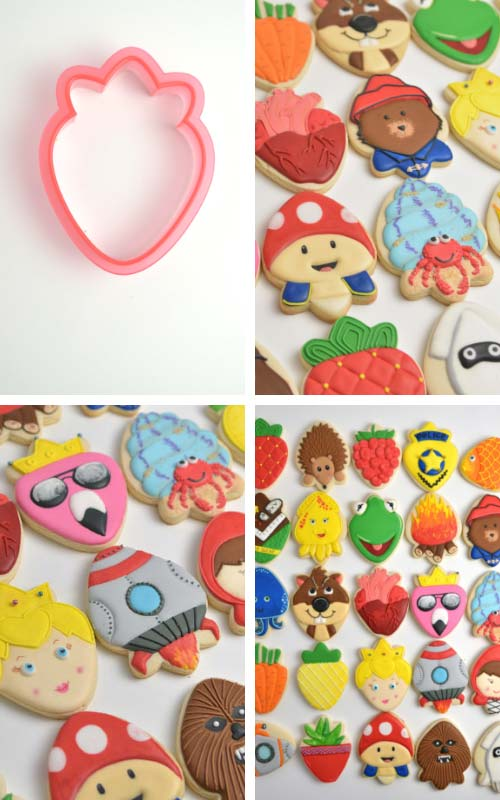 Plastic strawberry cookie cutter on white background.