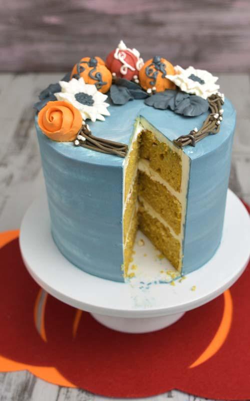 Cut cake displayed on a cutting board.