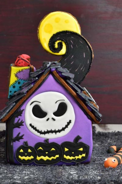 Decorated Nightmare before christmas gingerbread house on a table.