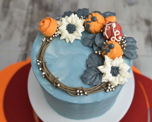 Detail showing top of the buttercream wreath cake.