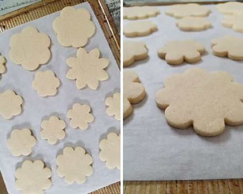Baked vegan flower cookies on a baking sheet lined with parchment paper.