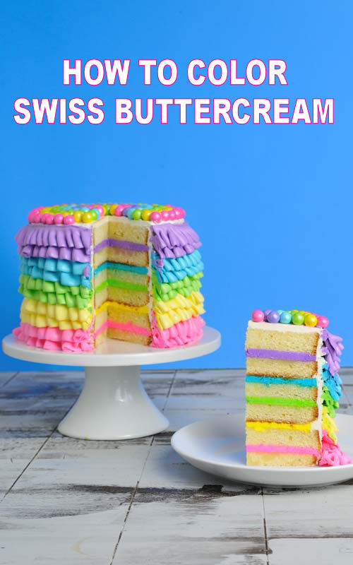 cake decorated with rainbow buttercream ruffles on a cake stand
