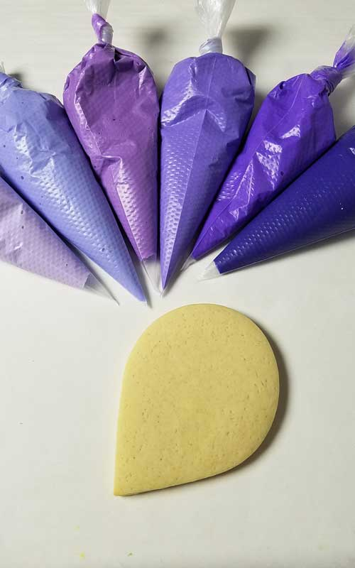 6 shades of purple icing in piping bags