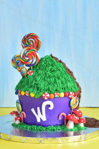 Willy Wonka cake Decorated with Rainbow Lollipops and Chocolate River