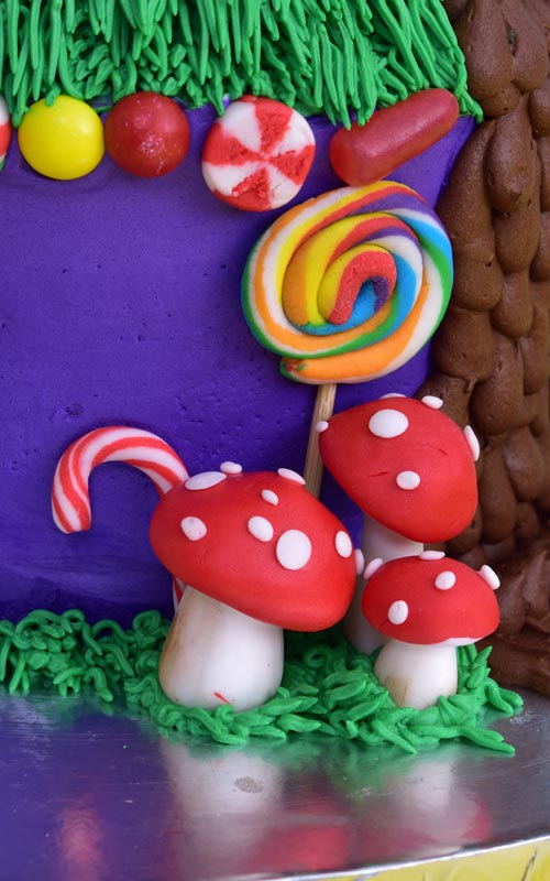 Willy Wonka Cake decorated with fondant lollipops, mushrooms and candy canes