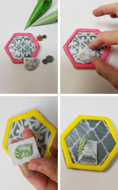Decorating cookie with royal icing pot and piped succulents.