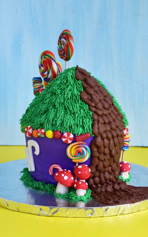 Buttercream Willy Wonka Cake with fondant lollipops, candy canes and mushrooms