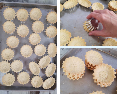 baked unfilled tart shells on a baking sheet