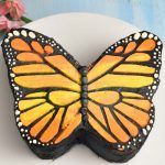 monarch butterfly cake on a cake stand